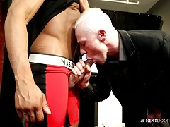 With special guest Trent King on hand to model a selection from Jockstrap Central, show host Ryan Russell is in hog heaven, especially when Trent removes his suit to reveal his favorite jockstrap, a little red and black number that can barely hold his mea