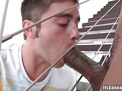 White boy can barely wrap his lips around black dude`s huge boner.